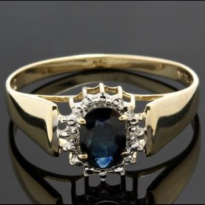 Jewelry - 10k gold ring with .52ctw diamonds and sapphire.